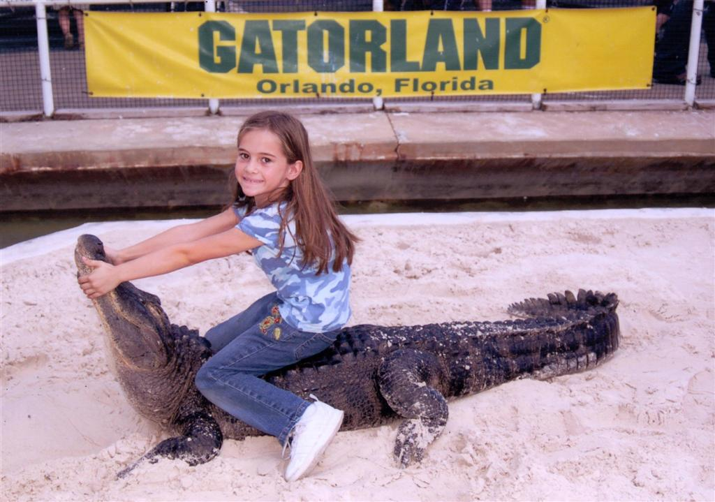Emily wrestling a live alligator